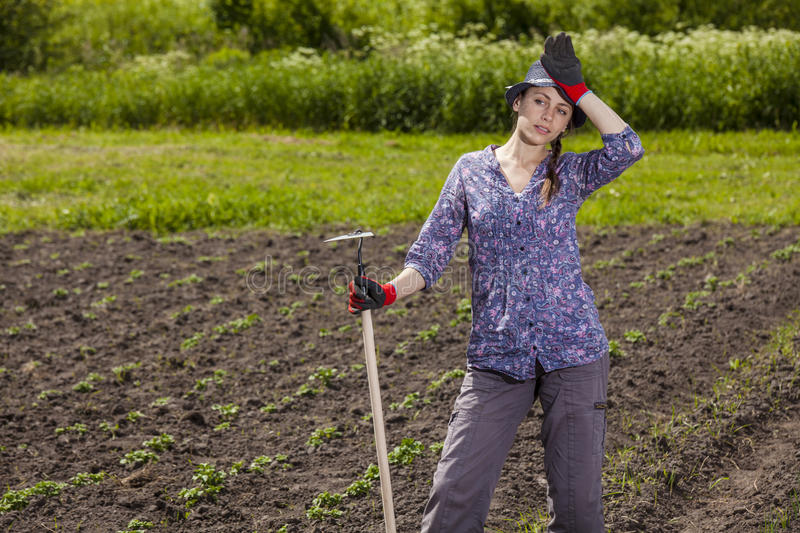 Woman tired at garden royalty free stock photo