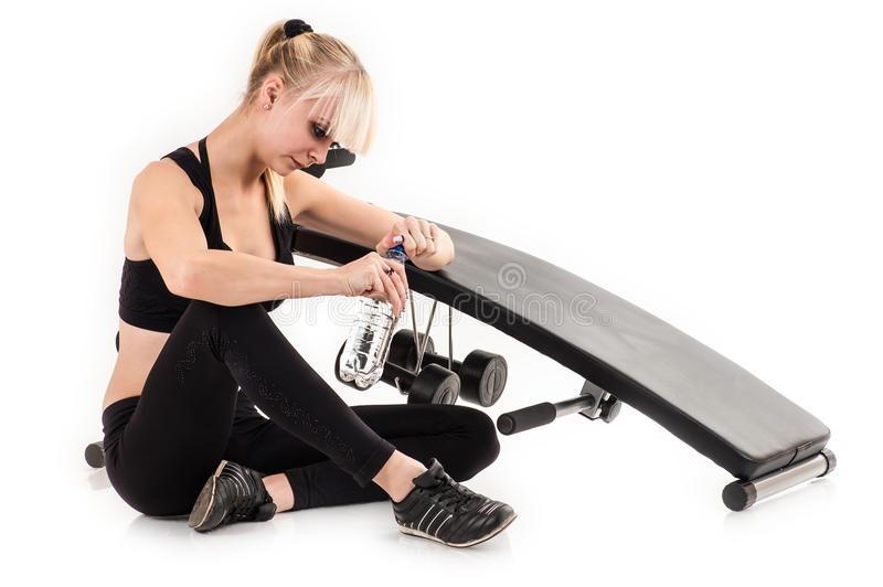 Woman tired from playing sports. Beautiful woman tired from playing sports stock image