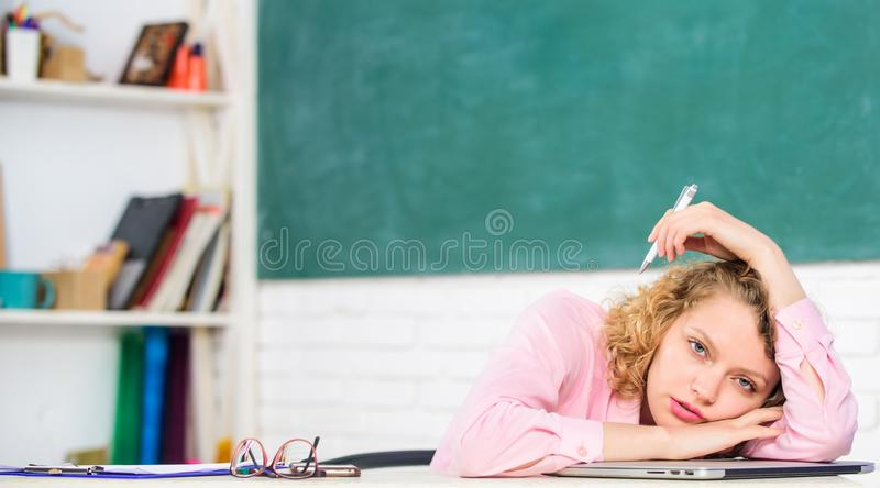 Woman tired in school classroom. Teacher exhausted after hard working day. School pedagogue stressful occupation. Tired. Tutor fall asleep at workplace. Tired royalty free stock photo