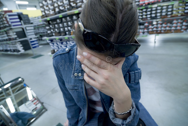 Woman tired of shopping. Stress and sorrow stock photo