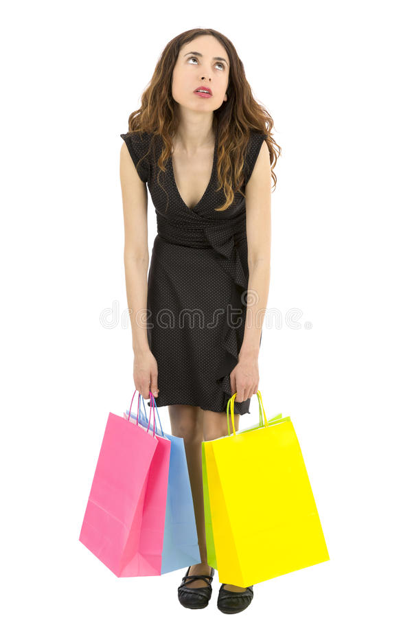 Woman tired of shopping. Shopaholic woman tired and exhausted carrying shopping bags stock image