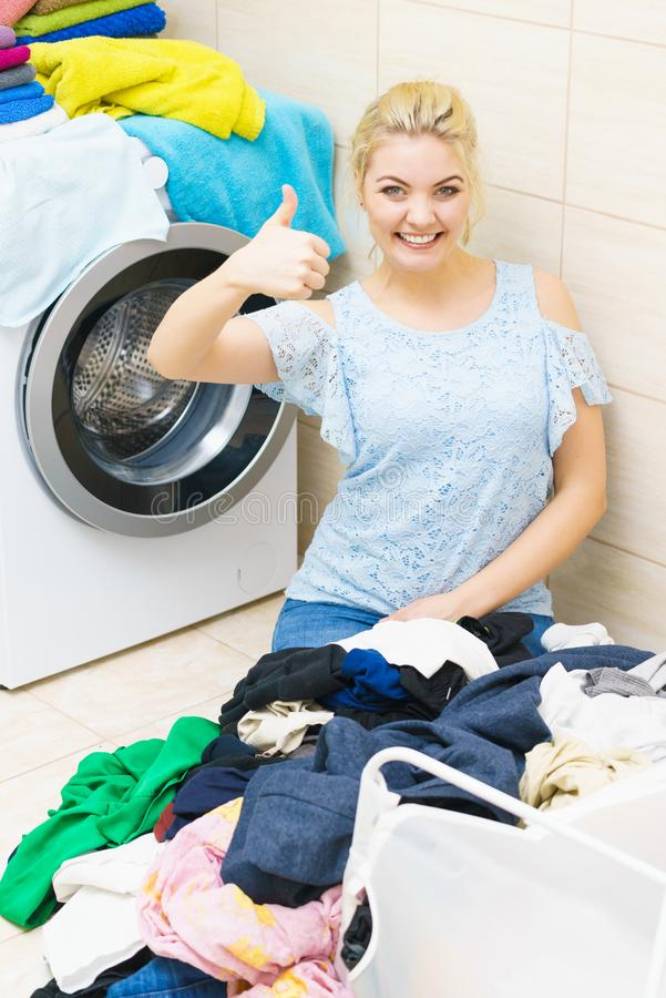 Woman doing laundry in bathroom royalty free stock images