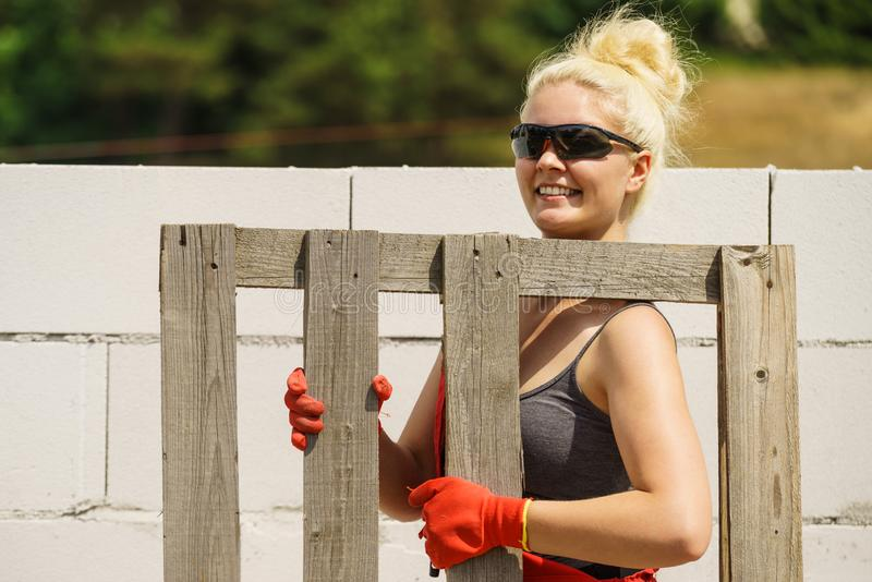Woman working with pallets on construction site royalty free stock photos