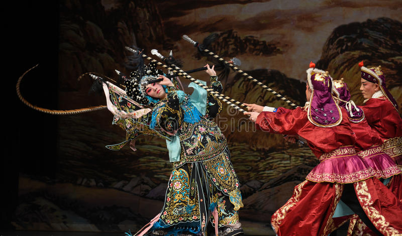 """A woman to fight many people- Beijing Opera"""" Women Generals of Yang Family"""". This opera tells a patriotic story how does an old woman of a hundred royalty free stock photo"""