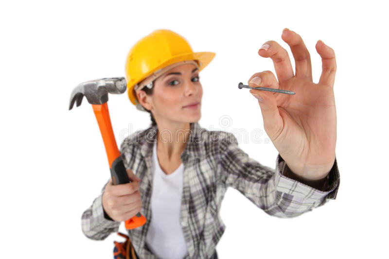Woman about to hit nail royalty free stock photography