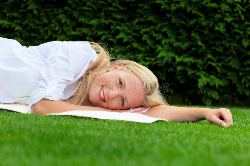 Download Woman Is To Relax In The Meadow Royalty Free Stock Images - Image: 25862459