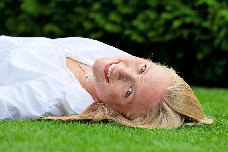 Woman is to relax in the meadow stock photo