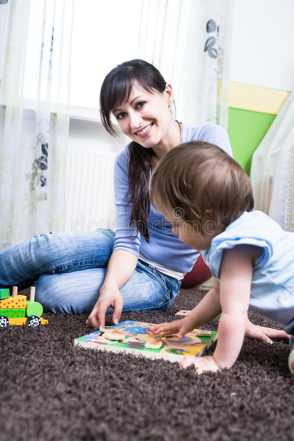 Download Woman with a toddler stock photo. Image of family, room - 27595774