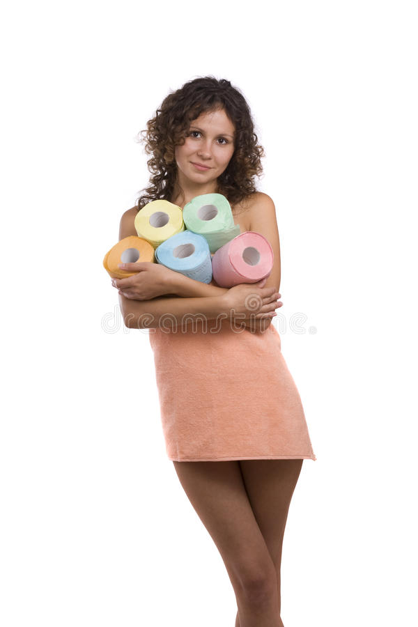 Woman with toilet paper. Woman wrapped in a peach-coloured bath towel with toilet papers. Smiley girl with roll of colored toilet paper. Isolated over white royalty free stock photography