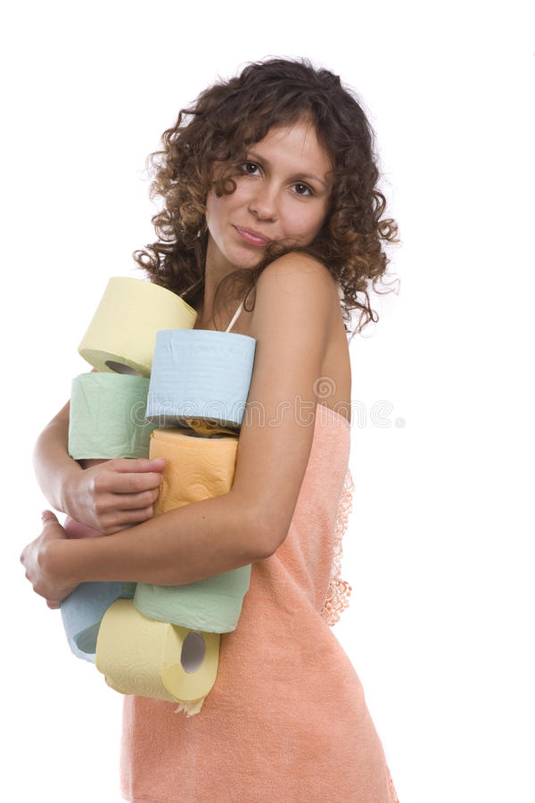 Woman with toilet paper. Girl wearing towel with toilet paper. Smiley woman with roll of colored toilet paper. Isolated over white background. Female hand stock image
