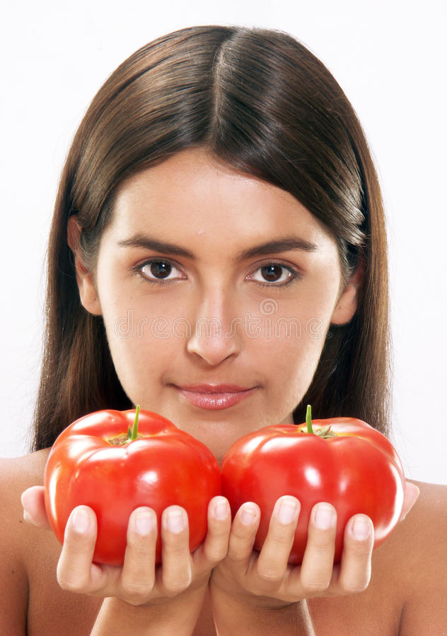 Woman tomatoes. royalty free stock photography