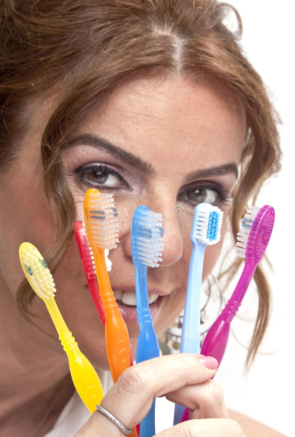 Woman with tooth brushes stock photo