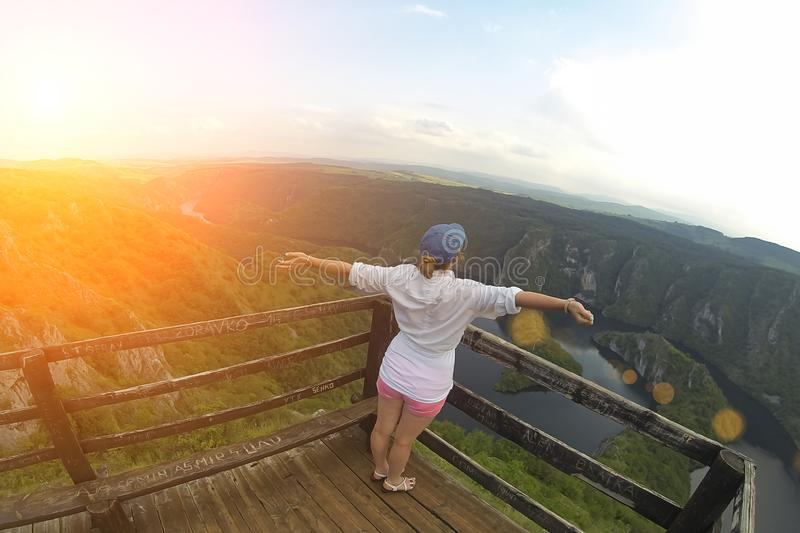 Woman on the top of the hill and panorama of Canyon Uvac in Serbia. At wooden platform view point.  royalty free stock photos