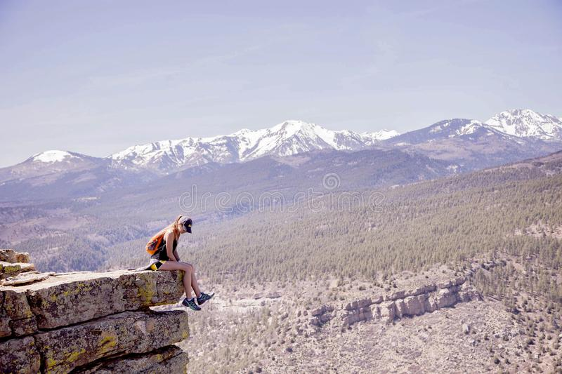 Woman On Top Of Mountain royalty free stock photo