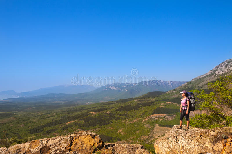 Woman on top of the rock stock photo