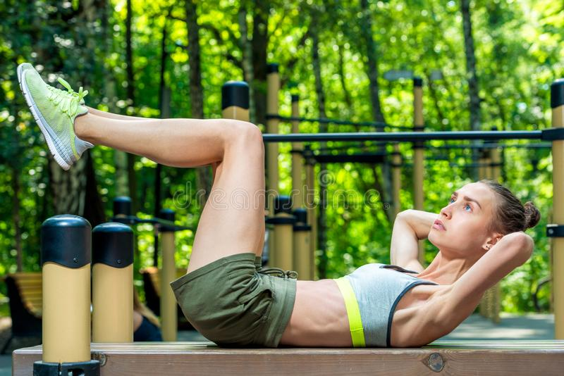 Woman in top and shorts playing sports outdoors royalty free stock images