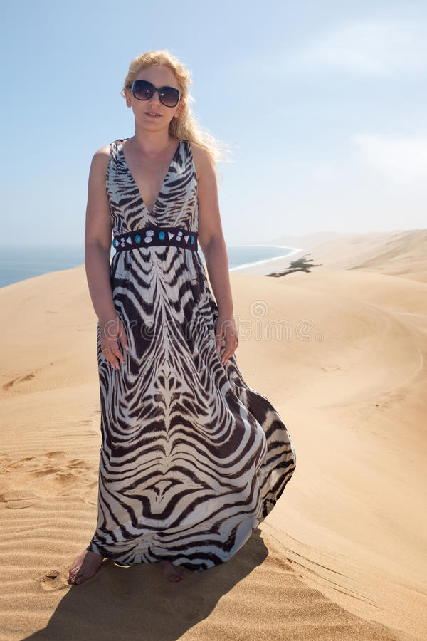 Woman on the tope of dune royalty free stock photo