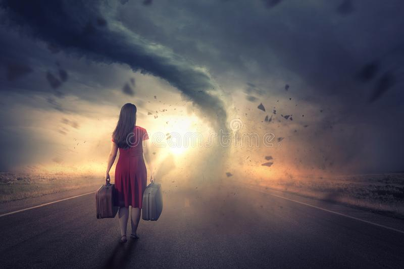 Woman and tornado stock image