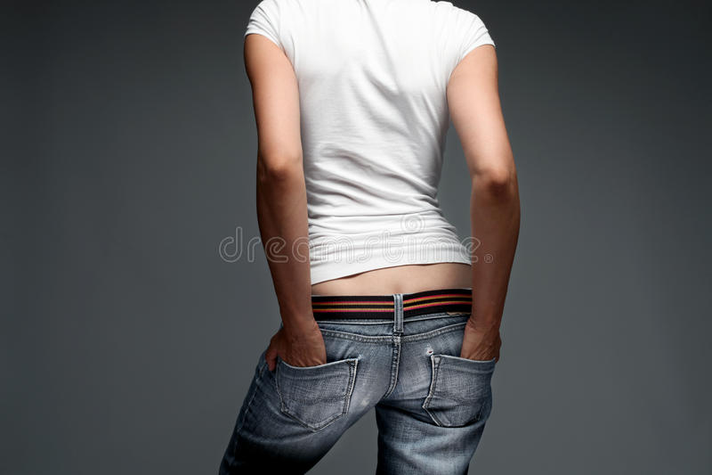 woman torso in jeans back royalty free stock photo