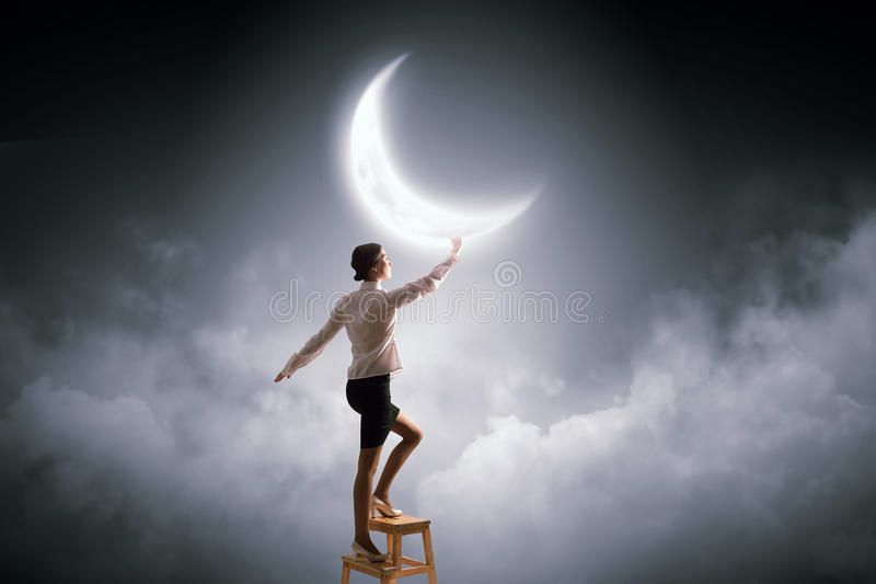 Woman touch the moon stock photos