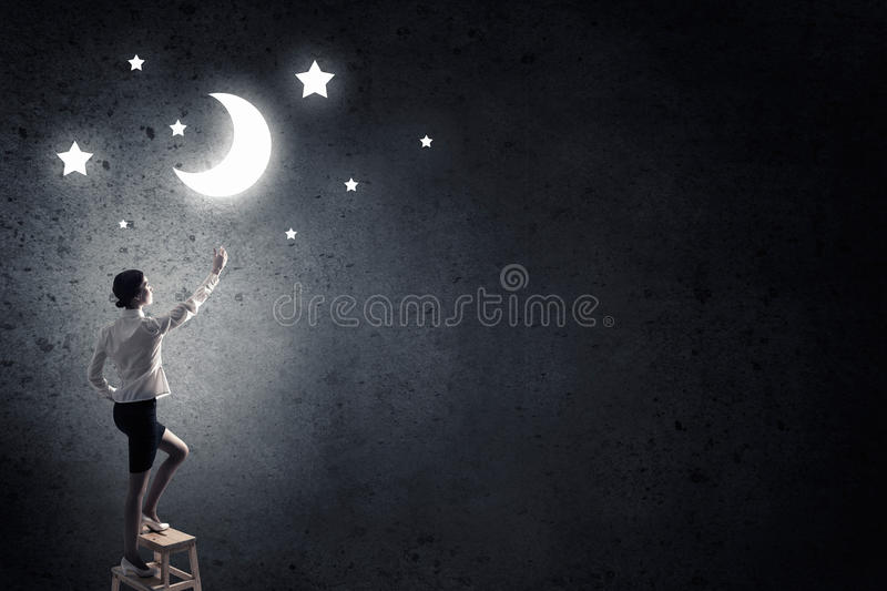 Woman touch the moon royalty free stock photos