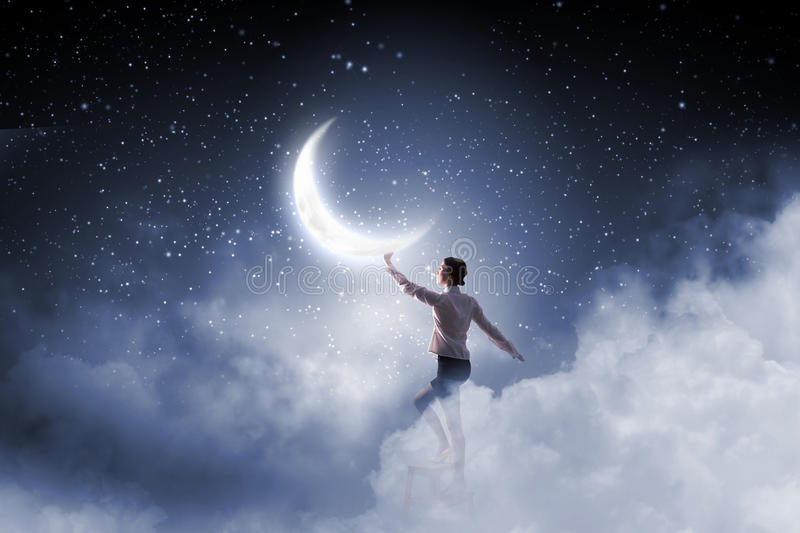 Woman touch the moon royalty free stock photo