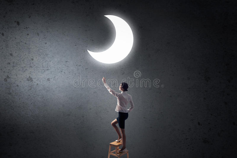 Woman touch the moon royalty free stock photography