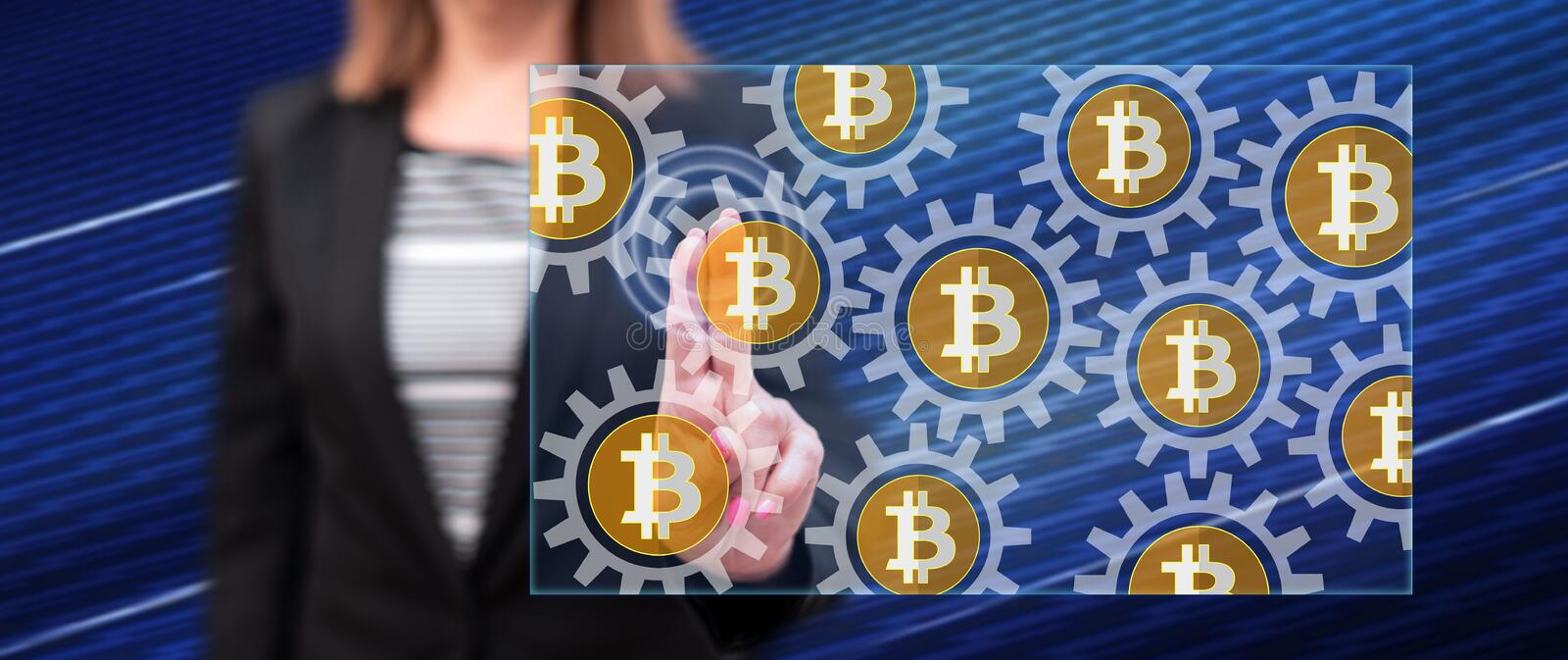 Woman touching a bitcoin concept royalty free stock image