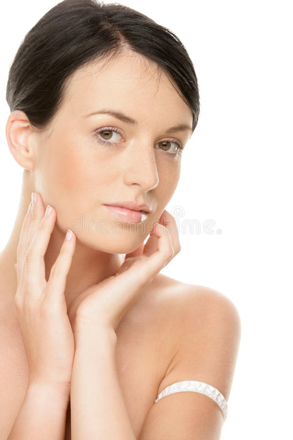 Woman touching face stock photography