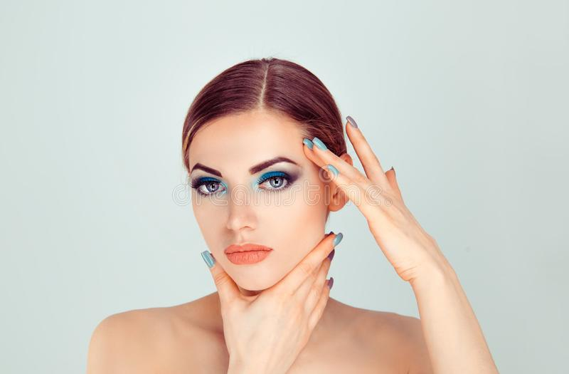 Woman touching face with hands showing perfect makeup and soft skin royalty free stock images