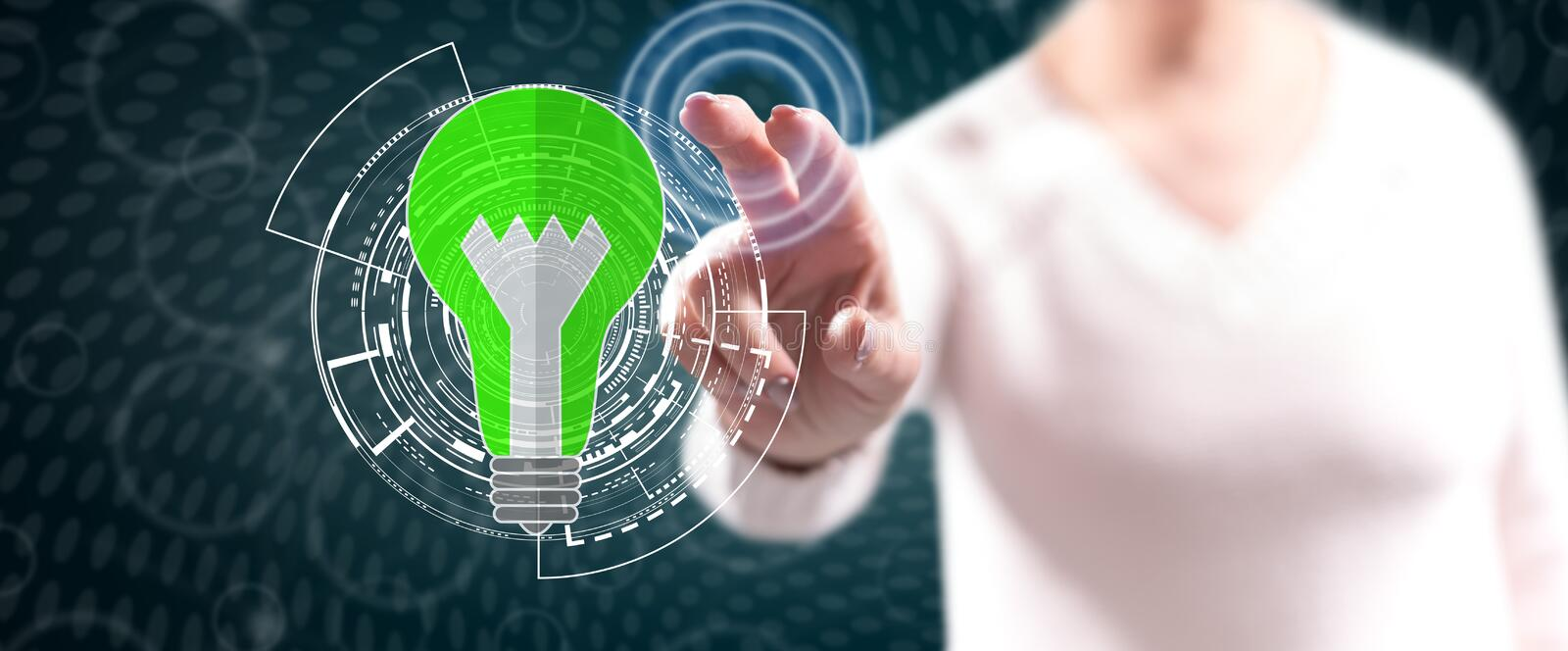 Woman touching a green energy concept royalty free stock photos