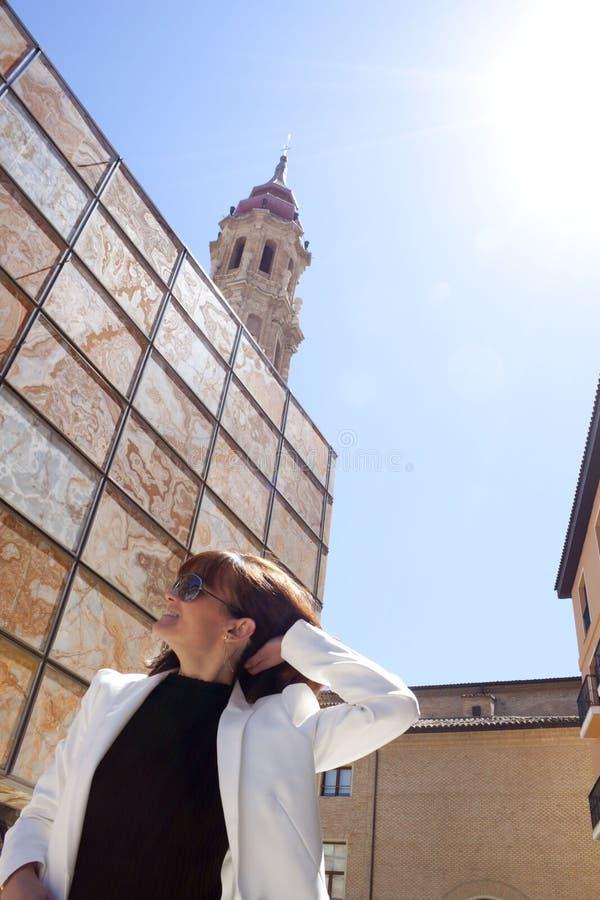 Woman touching her hair in La Seo square. Zaragoza, Spain stock image