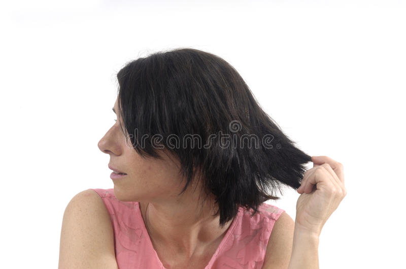 Woman touching her hair on white. Background royalty free stock photo