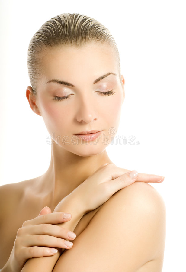 Woman touching her skin royalty free stock photos