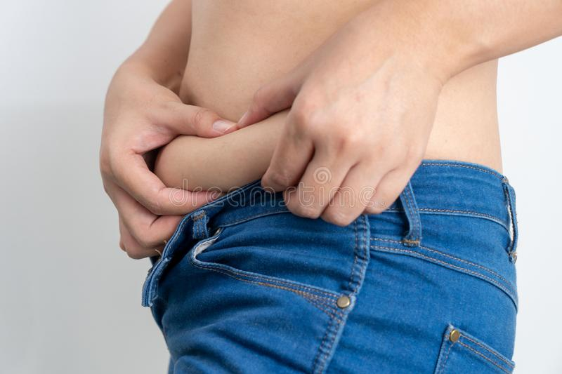 Woman touching his fat belly has overweight stock photos