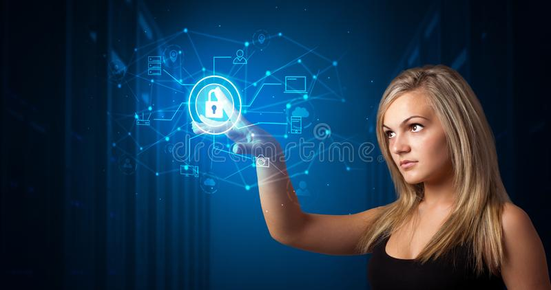 Woman touching hologram stock photography