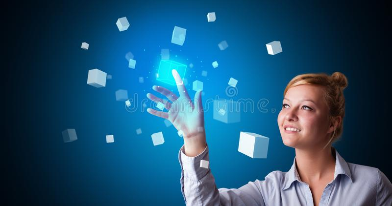 Woman touching hologram royalty free stock photography