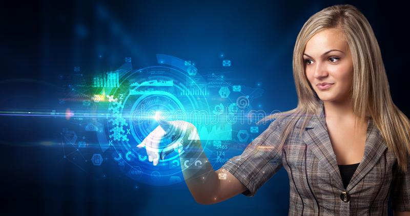 Woman touching hologram screen royalty free stock photography