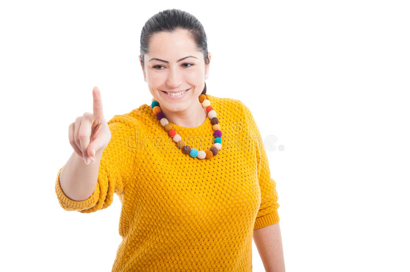 Woman touching imaginary screen with her finger. Looking happy as modern innovation concept isolated on white royalty free stock image