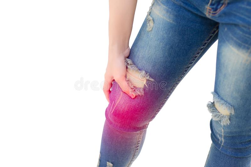 Woman touching knee, pain in joints, problems with knees royalty free stock photo