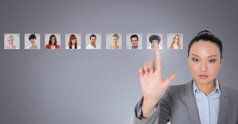 Woman touching portrait profiles of different people stock photos