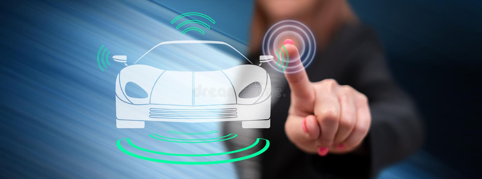 Woman touching a smart car concept. On a touch screen with her finger royalty free stock photo