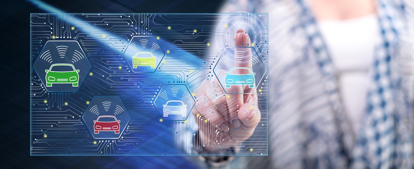 Woman touching a smart car concept. On a touch screen with her finger royalty free stock images