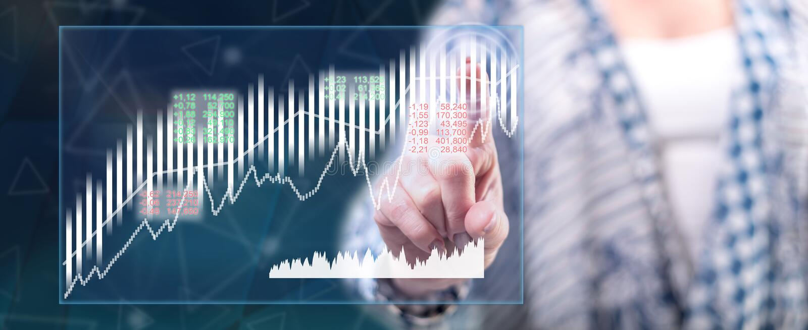 Woman touching a stock market concept. On a touch screen with her finger stock images