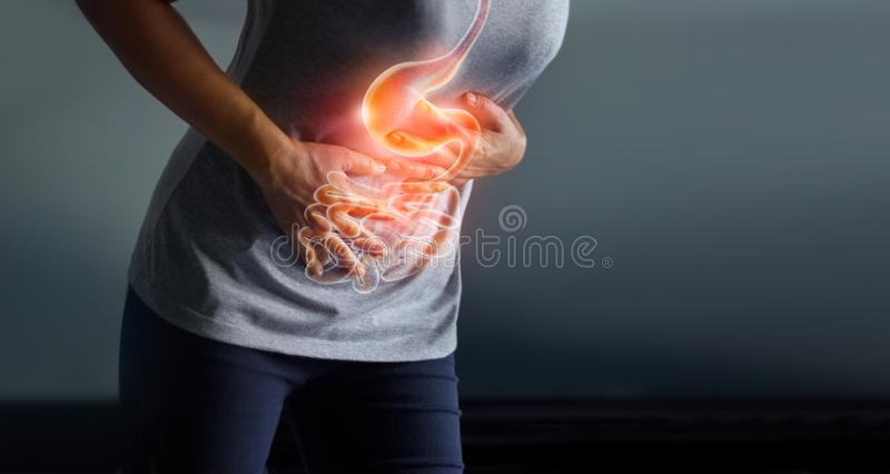 Woman touching stomach painful from stomachach. Woman touching stomach painful suffering from stomachache causes of menstruation period, gastric ulcer royalty free stock photos