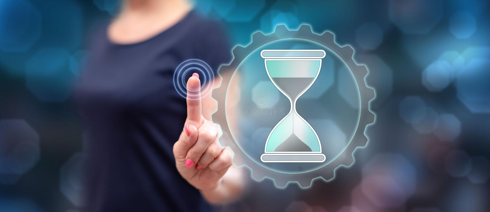 Woman touching a time management concept stock photo