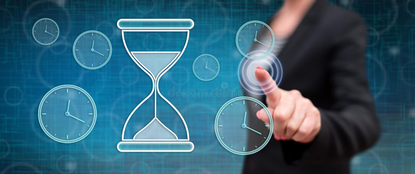 Woman touching a time management concept royalty free stock image
