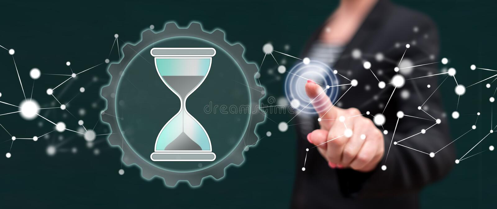 Woman touching a time management concept royalty free stock images