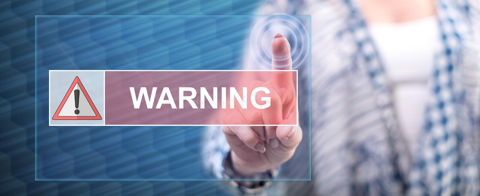 Woman touching a warning concept. On a touch screen with her finger stock images