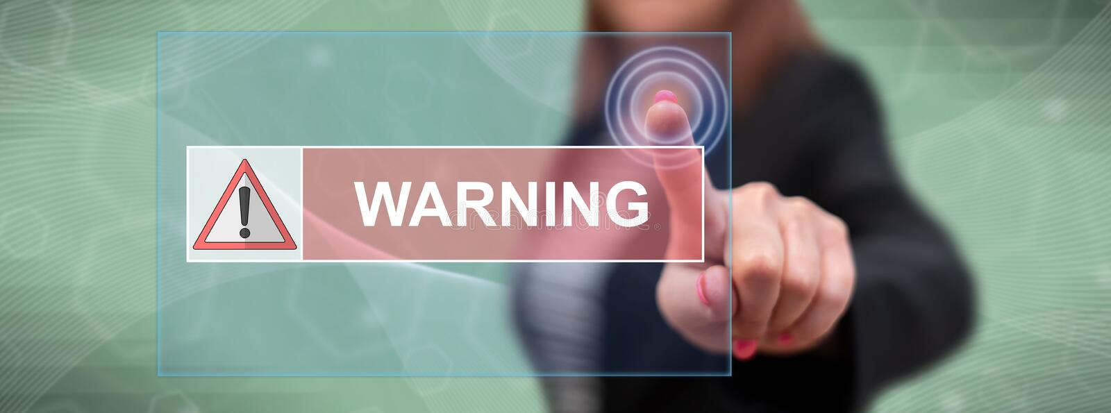 Woman touching a warning concept. On a touch screen with her finger royalty free stock images